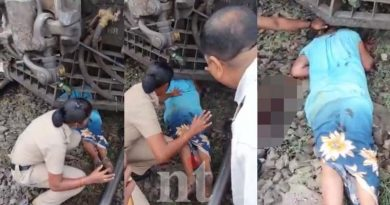 old-woman-stuck-under-a-train-railway-police-rescue