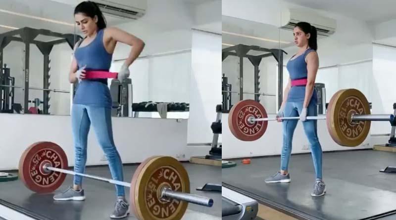 Samantha lifting 100 kg weight
